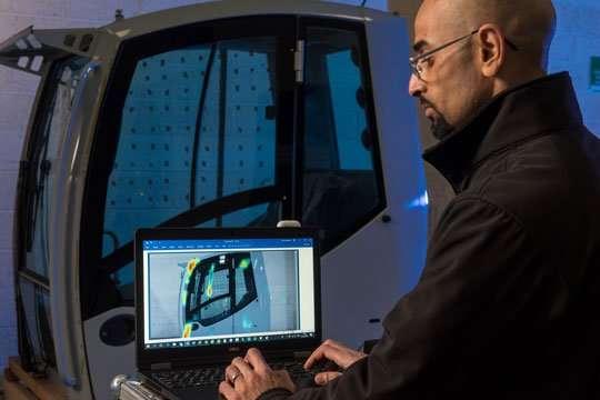 Ventac engineer testing vehicle in acoustic lab